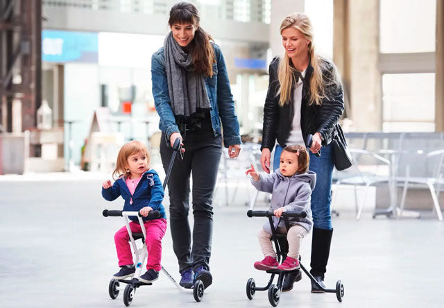 women using micro trike kids push pram buggy