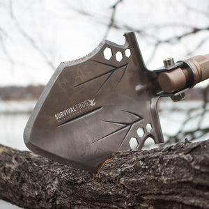 Tactical Shovel being used as a saw on tree