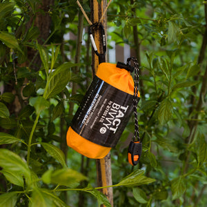 Tact bivy hanging from branch with carbiner