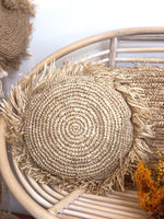 Round fringed raffia cushion