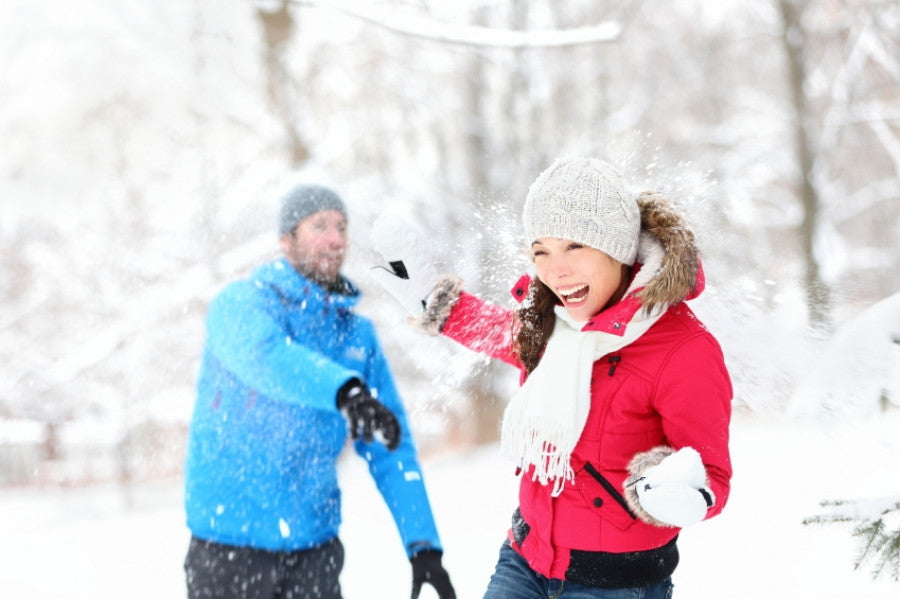Brush On Block image of man and woman in snowball fight