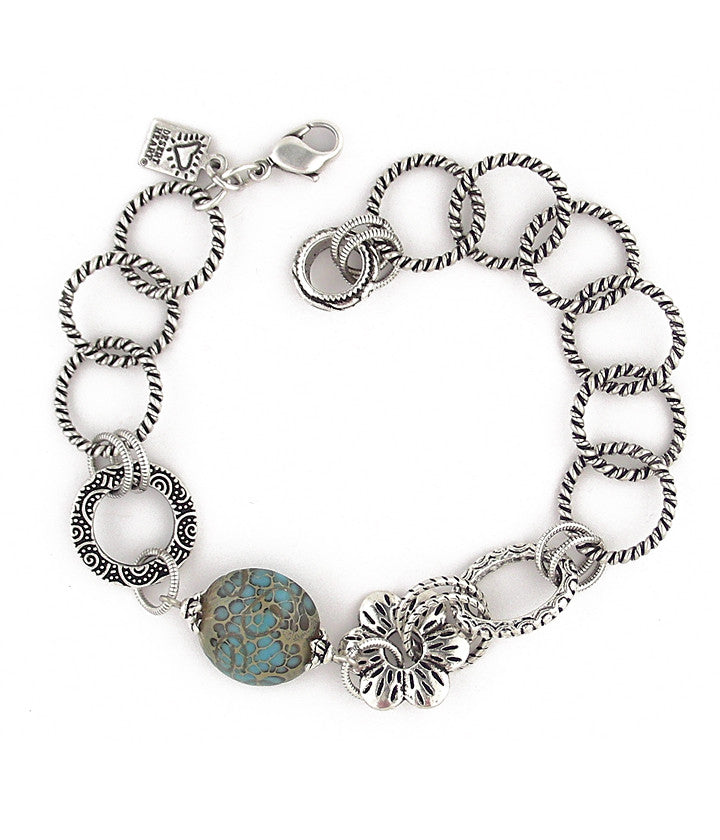 Cool bracelet with great glass, pewter and sterling plated and antiqued brass components. Extremely flexible sizing to 8""