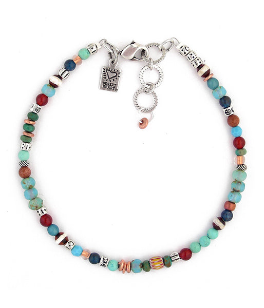 "Another winning color combo reminiscent of Santa Fe. Deep blues and reds with splashes of copper and light blue. Materials include trade beads, crystal, glass, pewter, carnelian and sterling plated brass. 9.25""-10.25"""