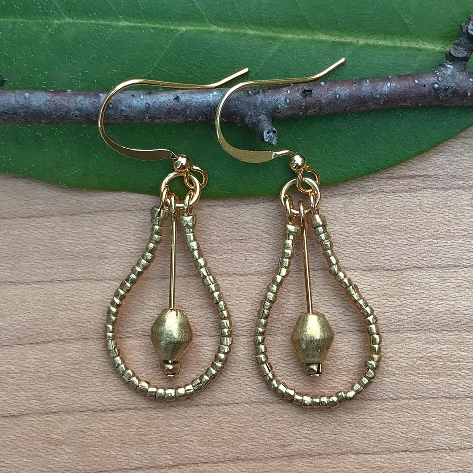 Fair trade brass earrings handmade by women in Ethiopia