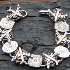 """Time Fly's "" Bracelet With Silver Clever Airplanes And Antique Watch Faces Accented With Swarovski Crystals"