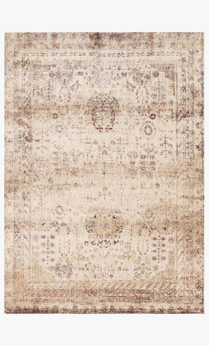 Ivory Egyptian inspired poly blend rug.