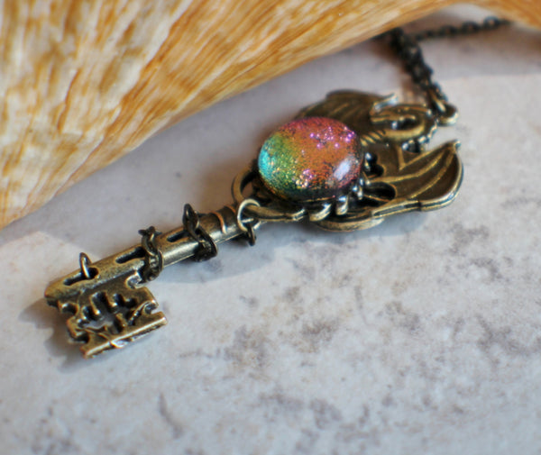 Dragon key necklace in bronze with a fused glass dichroic glass cabochon.