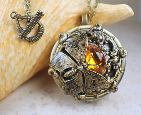Amber Crystal Butterfly Music Box Locket