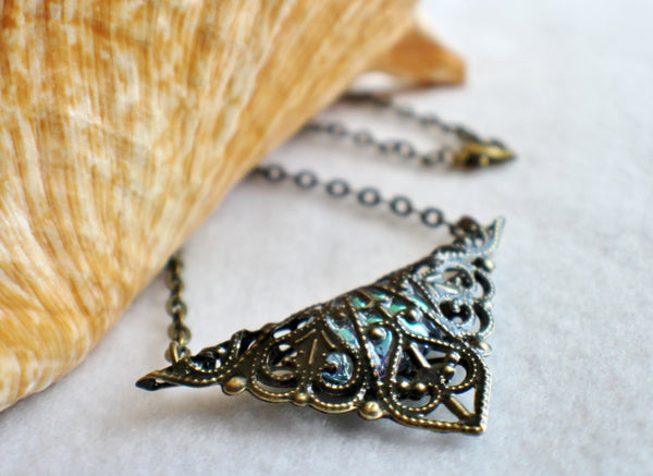 Triangle jewel necklace, bronze filigree triangle surrounds blue glass jewel. - Char's Favorite Things - 2