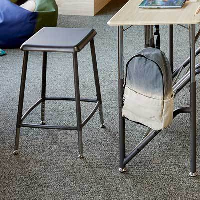 VARIDESK Stand2Learn Stool in classroom with desk