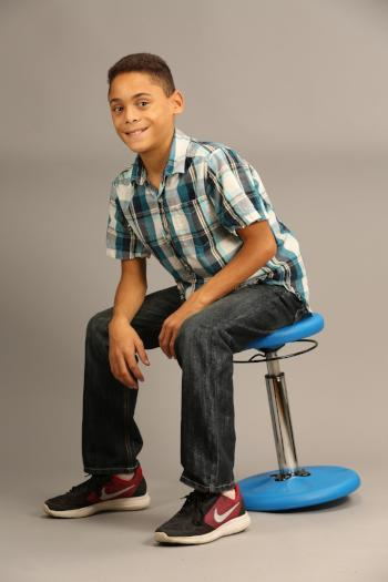 Boy using Kore Kids Height-Adjustable Wobble Chair Fitneff Canada