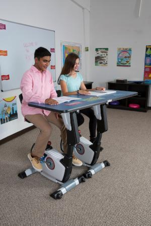 Kids using KidsFit Double Pedal Desk from Fitneff Canada - moving classroom