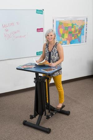 Woman using KidsFit Strider Desk from Fitneff Canada - active classroom