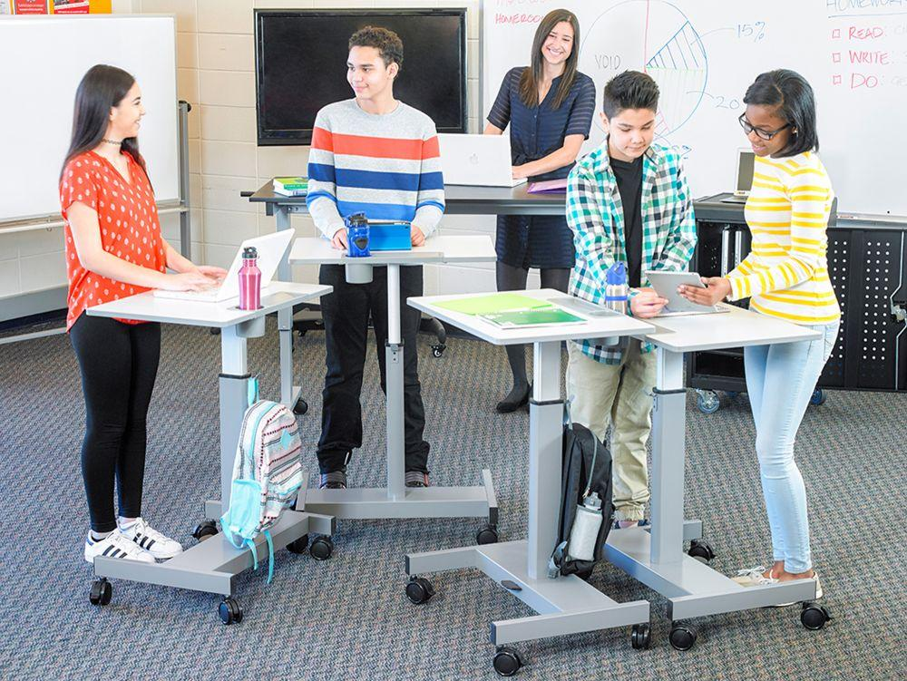 Adjustable student standing desk in classroom learning
