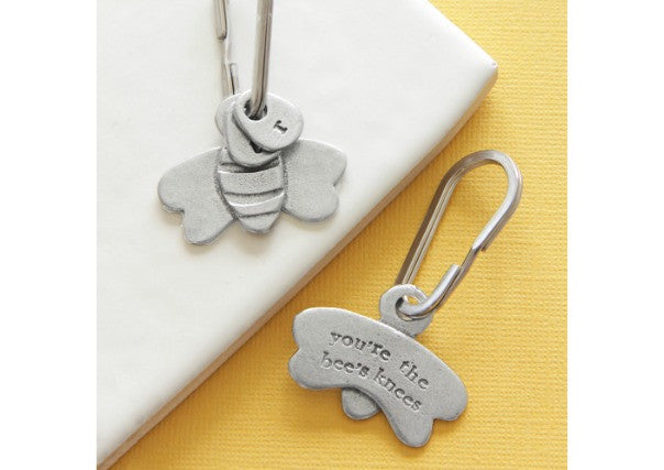 "Pewter Bee Keyring by Kutuu stamped with the phrase ""You're the bees knees"" on the back"