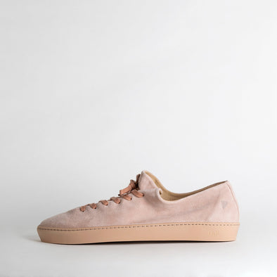 One piece light rose suede leather sneakers with a stitched plain rubber cup sole, shock proof innersole and cotton laces.