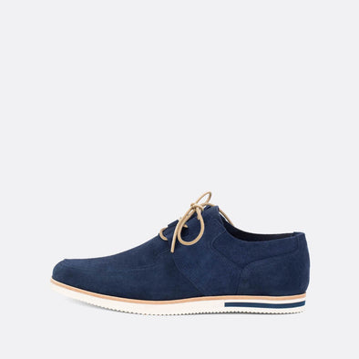 Comfortable blue suede shoes with a distinct sole.
