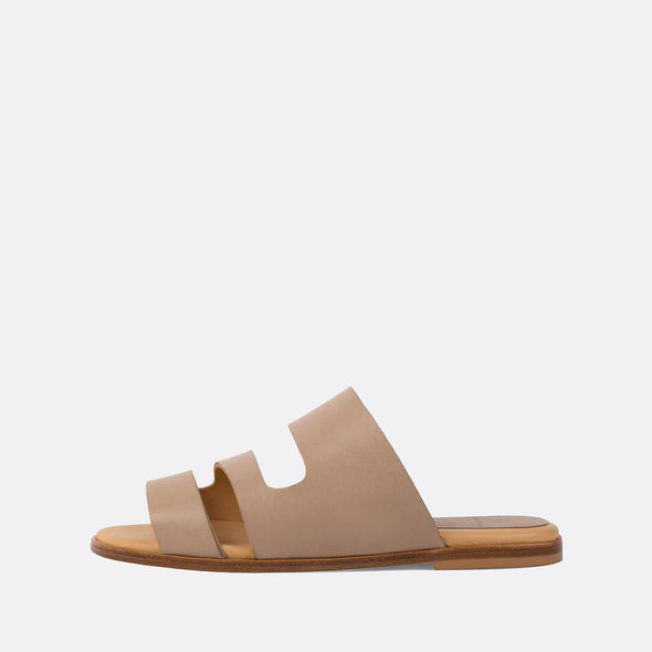 Minimalist triple-strap slides in nude leather.