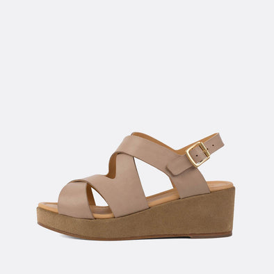 Minimalist cross-strap sandals with neutral toned suede platform sole.
