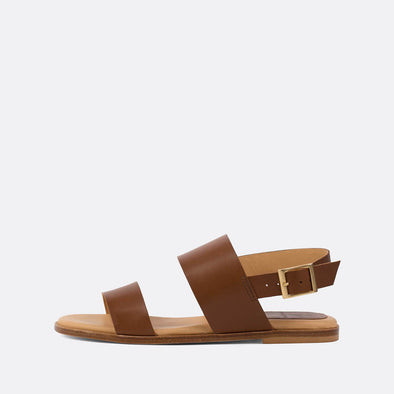 Minimalist double-strap sandals in brown leather.