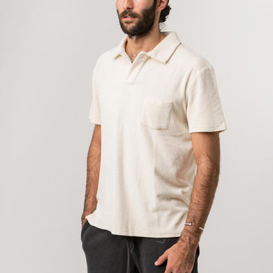 Off-white polo shirt cut from modal-blend terry.