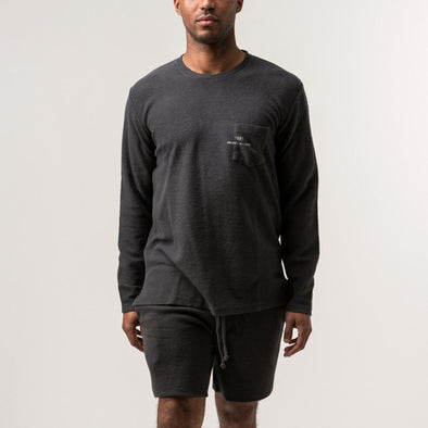 Minimalist dark grey 'inside-out' style rustic sweatshirt.