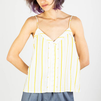 Feminine white top with yellow stripes, a v-neck ans thin straps.