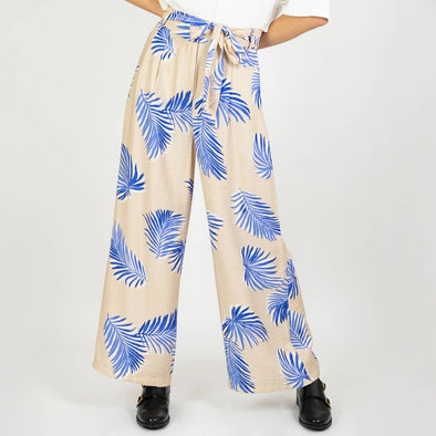 Beige cotton pants adorned with a floral print and belted waist.