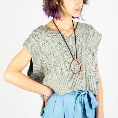 Mesh knit sweater in a grey-green color.