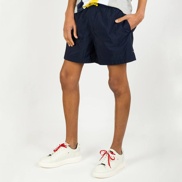 Regular fit swim shorts with a branded contrast ribbon and a comfortable elasticated drawstring waistband.