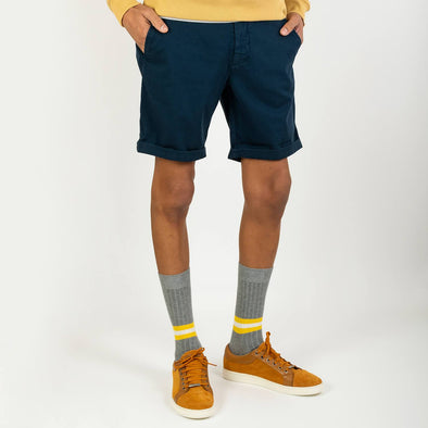 Navy blue colored regular fit shorts with a light tone on tone texture.