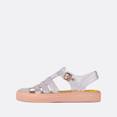 Transparent synthetic 90s style sandals with baby pink sole.