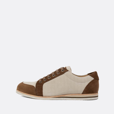Casual sneakers in beige and brown suede with subtle engraving.