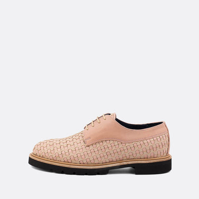 Light pink derby flat shoes with texture details.
