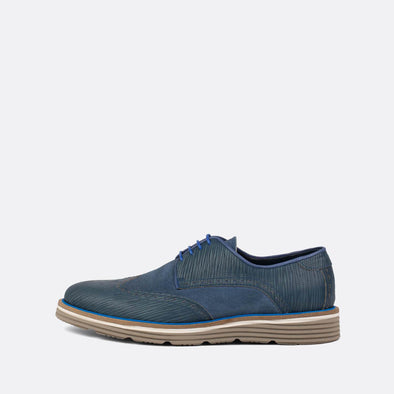 Casual blue derby shoes with texture details.
