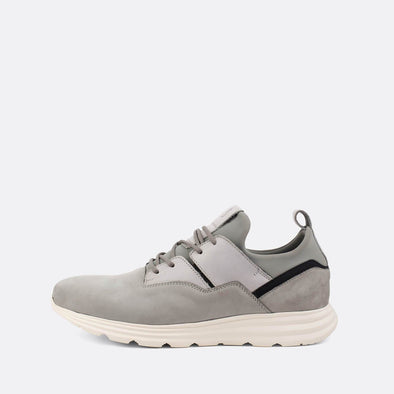 Grey suede runners with leather and neoprene details.