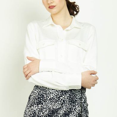 Minimalist long sleeved white shirt with two front pockets.