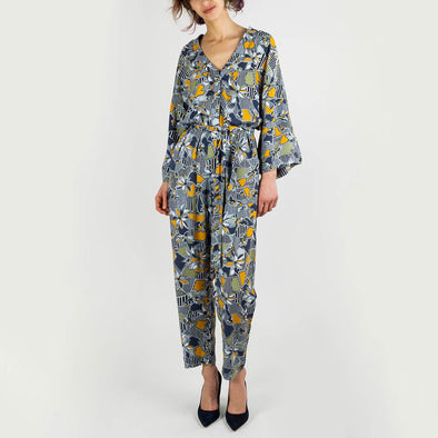 All over print jumpsuit with wide kimono sleeves, curved leg, concealed button placket on the front, side pockets and a tie waist.