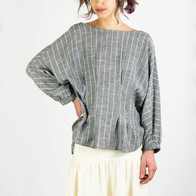 Grey blouse with white stripes, buttoned back and pleated waist.