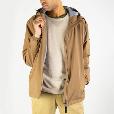 Light brown jacket with mechanical elasticity and 3K inner membrane for greater breathability.