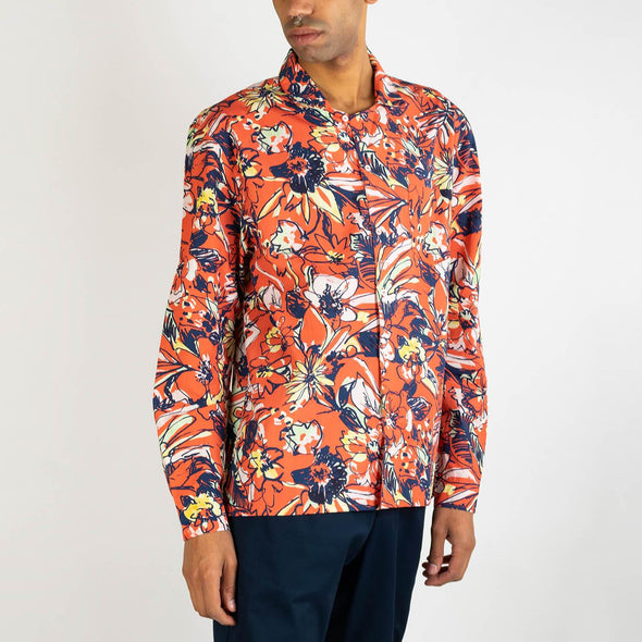 Long sleeved hawaiian shirt in red with a multicolored floral print.