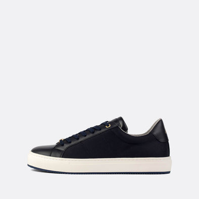 Navy blue leather and mesh low-top sneakers with golden details.