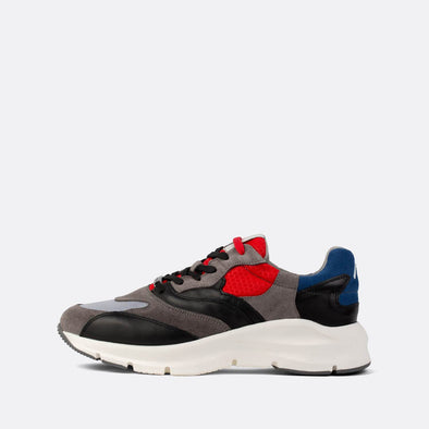 Multicolored runners in leather and suede with a vibrant white sole.