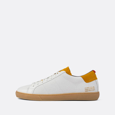 White leather low-top sneakers with mesh and camel suede details.