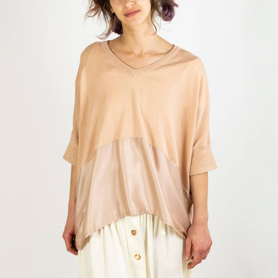 Blush colored relaxed fit knitted v-neck top with silk panel.