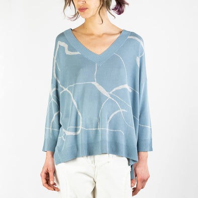 V-neck top with marble print and dip hem in light blue and light grey.