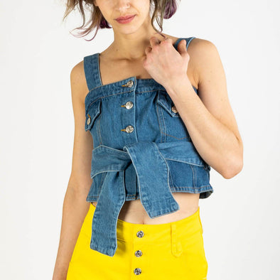 Cropped blue denim bustier featuring a front button fastening, adjustable and detachable shoulder straps.