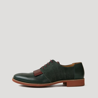 Green and brick versatile lace-up derbies fuse premium Italian leather with fine cork fabric.