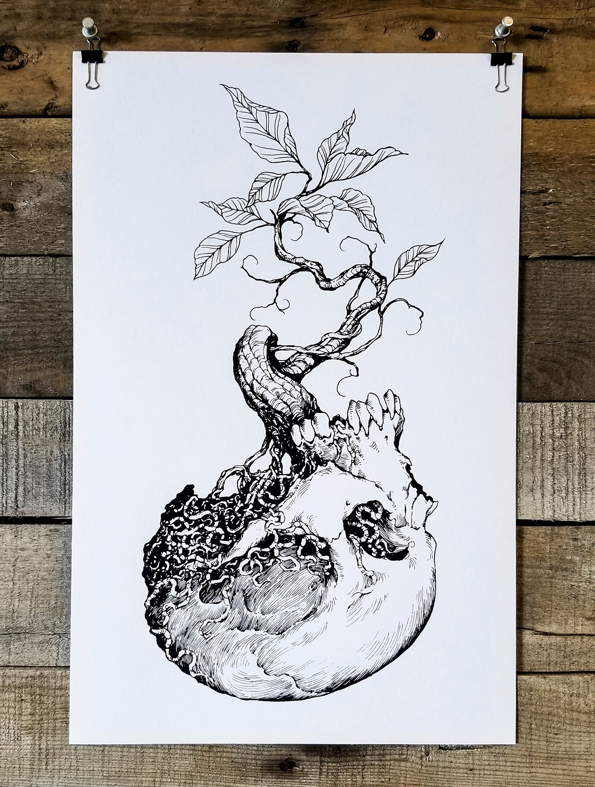 Black & White screen print by Brandon Stewart of a plant growing out of a skull