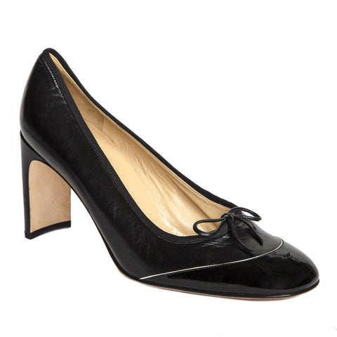 Find an authentic pair of preowned Chanel Black Patent Leather Shoes, size 41 (Italian) at BunnyJack, where each sale triggers a charity donation.